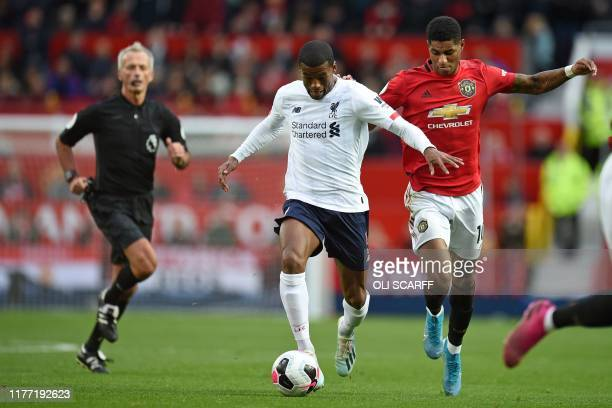 TOPSHOT Manchester United's English striker Marcus Rashford vies with Liverpool's Dutch midfielder Georginio Wijnaldum during the English Premier...