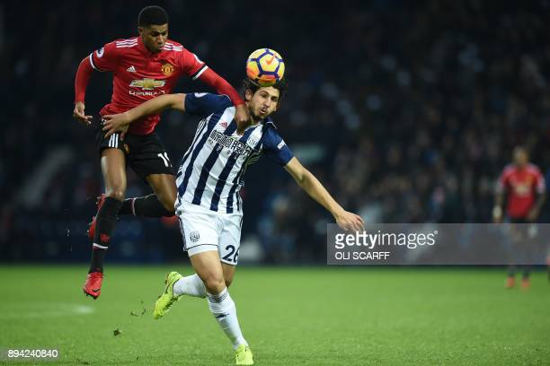 Manchester United's English striker Marcus Rashford vies with West Bromwich Albion's Egyptian defender Ahmed Hegazy during the English Premier League...