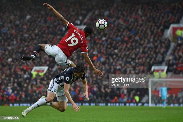 TOPSHOT Manchester United's English striker Marcus Rashford vies with West Bromwich Albion's English striker Jay Rodriguez during the English Premier...