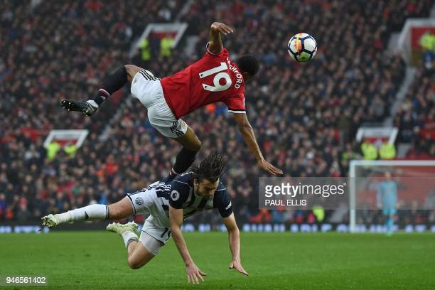 Manchester United's English striker Marcus Rashford vies with West Bromwich Albion's English striker Jay Rodriguez during the English Premier League...