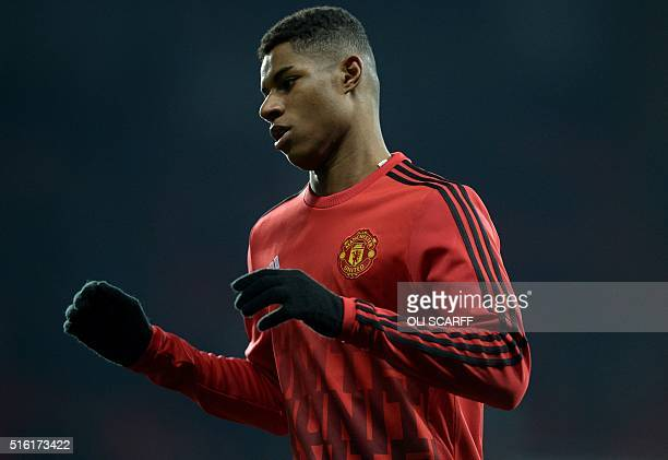 Manchester United's English striker Marcus Rashford warms up ahead of the UEFA Europa League round of 16 second leg football match between Manchester...