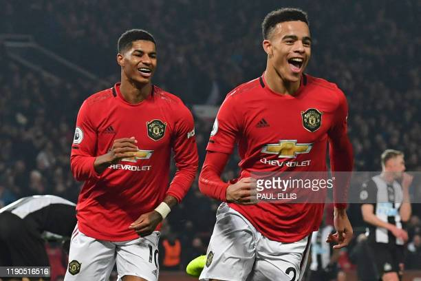 Manchester United's English striker Mason Greenwood celebrates after scoring their second goal during the English Premier League football match...