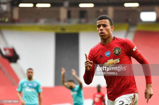 Manchester United's English striker Mason Greenwood celebrates after scoring a goal during the English Premier League football match between...