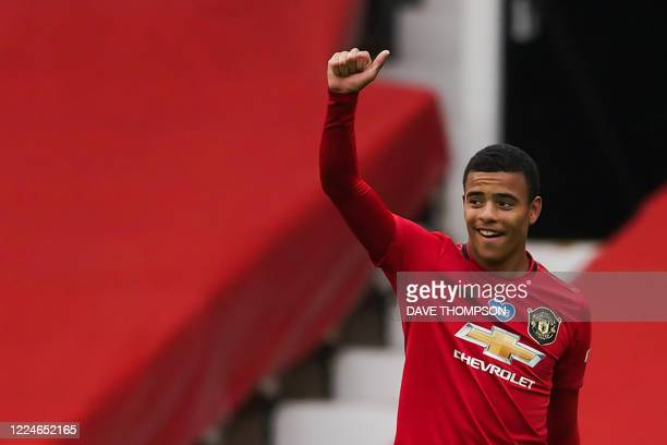 Manchester United's English striker Mason Greenwood celebrates after scoring a goal eduring the English Premier League football match between...