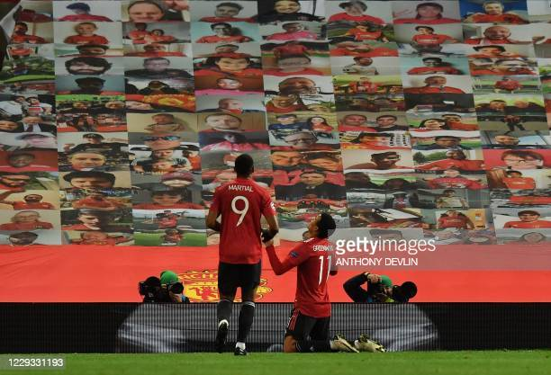 Manchester United's English striker Mason Greenwood celebrates scoring the opening goal during the UEFA Champions league group H football match...