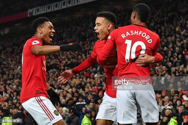 Manchester United's English striker Mason Greenwood celebrates with Manchester United's French striker Anthony Martial and Manchester United's...