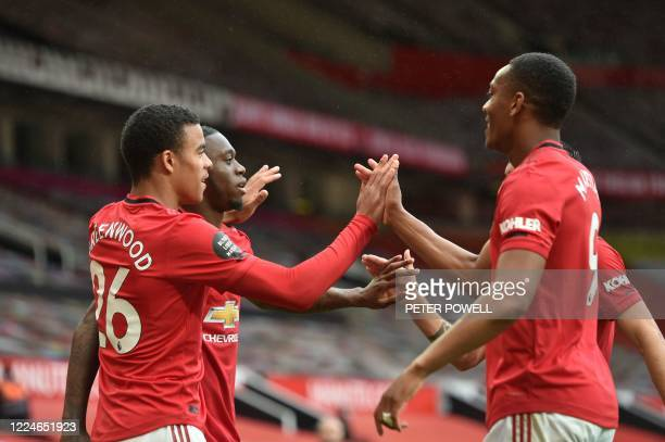 Manchester United's English striker Mason Greenwood celebrates with teammates after scoring a goal during the English Premier League football match...