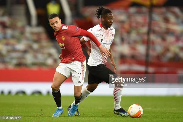 Manchester United's English striker Mason Greenwood challenges AC Milan's French midfielder Soualiho Meite during the UEFA Europa League round of 16...