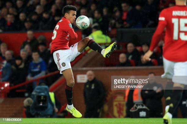Manchester United's English striker Mason Greenwood controls the ball during the English League Cup quarterfinal football match between Manchester...