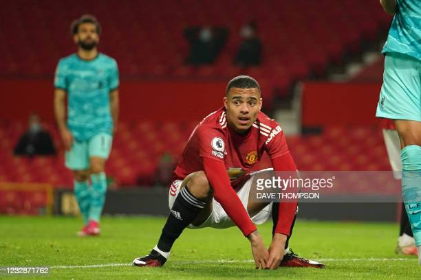 Manchester United's English striker Mason Greenwood reacts to a missed chance during the English Premier League football match between Manchester...