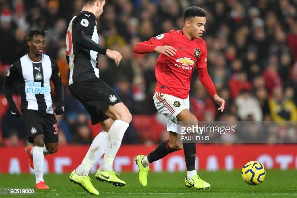 Manchester United's English striker Mason Greenwood runs with the ball during the English Premier League football match between Manchester United and...