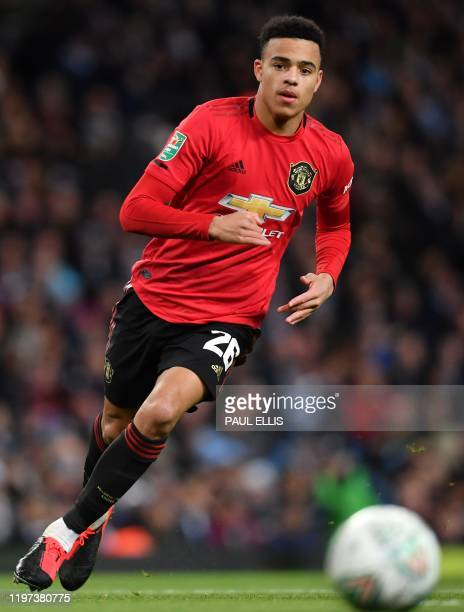 Manchester United's English striker Mason Greenwood runs with the ball during the English League Cup semi-final second leg football match between...