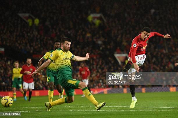 Manchester United's English striker Mason Greenwood scores their fourth goal during the English Premier League football match between Manchester...
