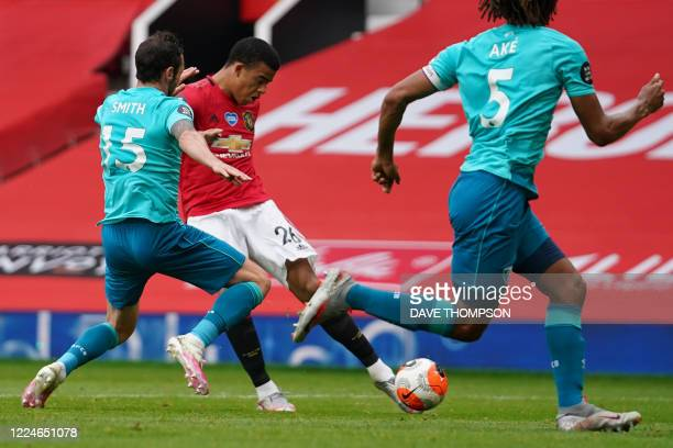 Manchester United's English striker Mason Greenwood shoots and scores a goal during the English Premier League football match between Manchester...