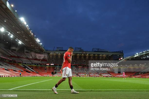 Manchester United's English striker Mason Greenwood walks around the pitch having been substituted during the English Premier League football match...