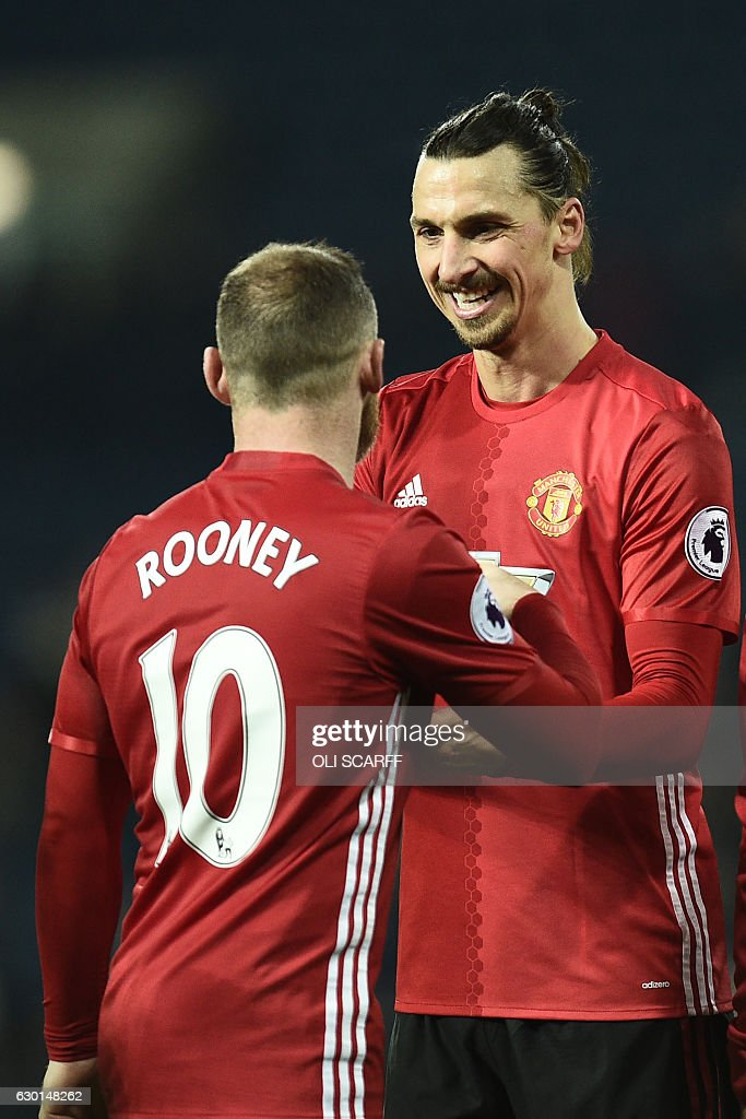 Manchester United's English striker Wayne Rooney (L) and Manchester United's Swedish striker Zlatan Ibrahimovic celebrate on the pitch after the English Premier League football match between West Bromwich Albion and Manchester United at The Hawthorns stadium in West Bromwich, central England, on December 17, 2016. Manchester United won the game 2-0. / AFP / Oli SCARFF / RESTRICTED TO EDITORIAL USE. No use with unauthorized audio, video, data, fixture lists, club/league logos or 'live' services. Online in-match use limited to 75 images, no video emulation. No use in betting, games or single club/league/player publications. /