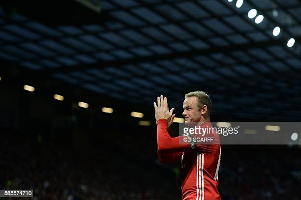 Manchester United's English striker Wayne Rooney applauds during the friendly Wayne Rooney testimonial football match between Manchester United and...
