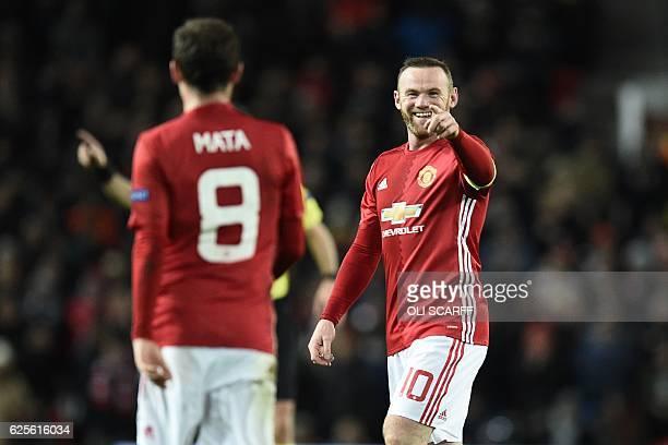 TOPSHOT Manchester United's English striker Wayne Rooney celebrates after Manchester United's Spanish midfielder Juan Mata scored their second goal...