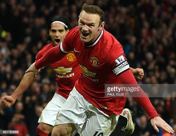 Manchester United's English striker Wayne Rooney celebrates scoring a penalty during the English Premier League football match between Manchester...
