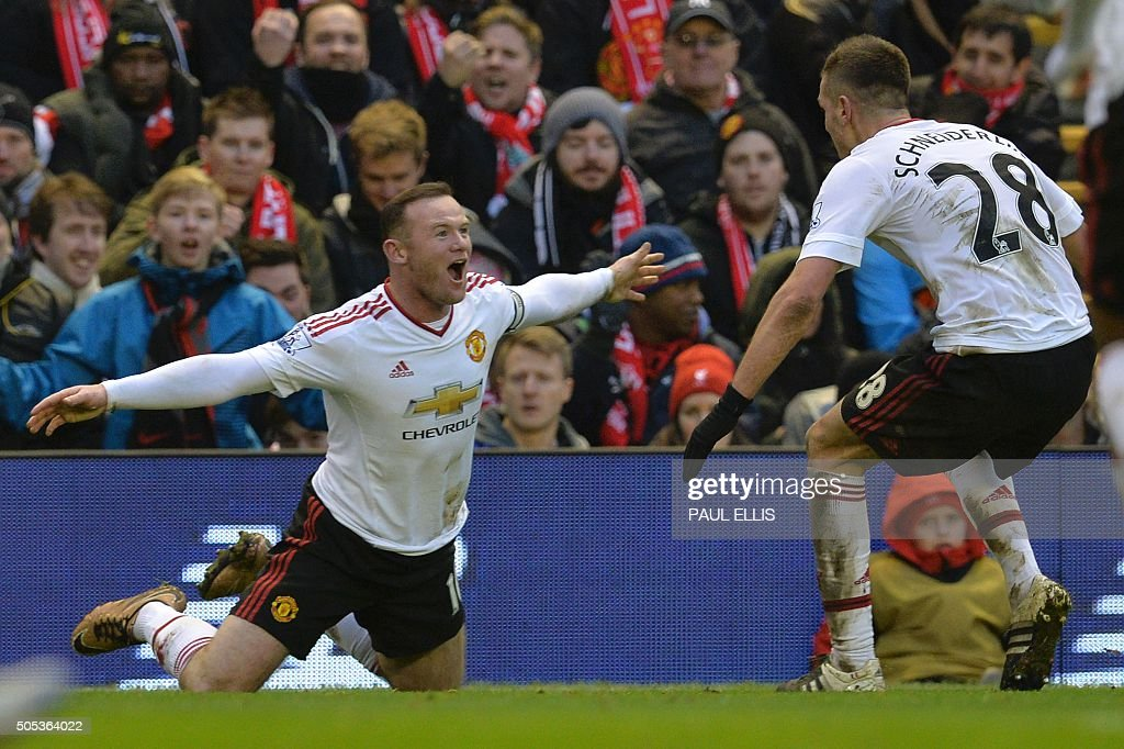 TOPSHOT - Manchester United's English striker Wayne Rooney (L) celebrates scoring the opening goal during the English Premier League football match between Liverpool and Manchester United at Anfield in Liverpool, northwest England, on January 17, 2016. / AFP / PAUL