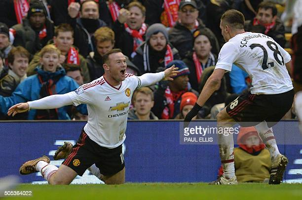 TOPSHOT Manchester United's English striker Wayne Rooney celebrates scoring the opening goal during the English Premier League football match between...