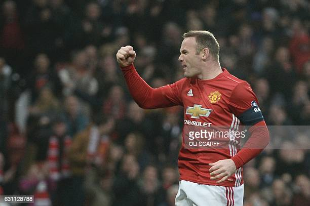 Manchester United's English striker Wayne Rooney celebrates scoring the opening goal and equalling Bobby Charlton's Manchester United alltime scoring...
