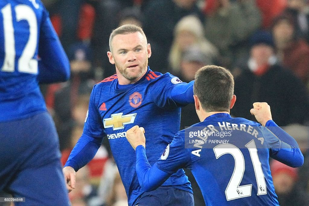 Manchester United's English striker Wayne Rooney (C) celebrates scoring the equalising goal for 1-1 and his 250th goal for Manchester United making him the club's all-time record scorer during the English Premier League football match between Stoke City and Manchester United at the Bet365 Stadium in Stoke-on-Trent, central England on January 21, 2017. / AFP / Lindsey PARNABY / RESTRICTED TO EDITORIAL USE. No use with unauthorized audio, video, data, fixture lists, club/league logos or 'live' services. Online in-match use limited to 75 images, no video emulation. No use in betting, games or single club/league/player publications. /