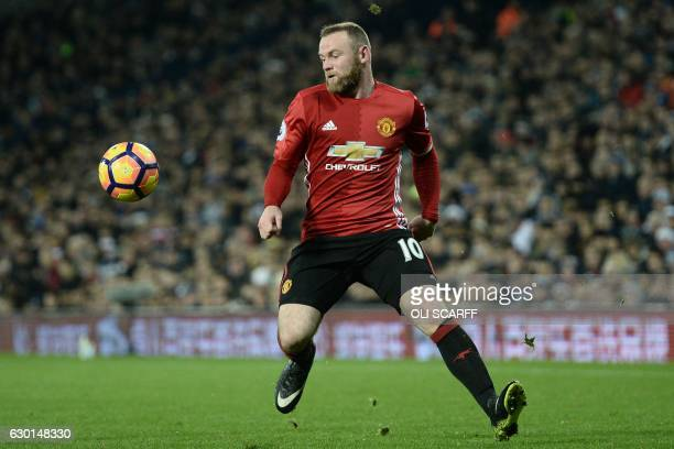 Manchester United's English striker Wayne Rooney controls the ball during the English Premier League football match between West Bromwich Albion and...