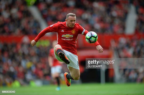 TOPSHOT Manchester United's English striker Wayne Rooney controls the ball during the English Premier League football match between Manchester United...