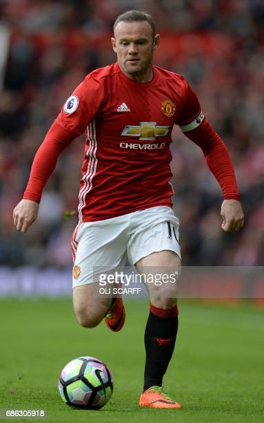 Manchester United's English striker Wayne Rooney controls the ball during the English Premier League football match between Manchester United and...