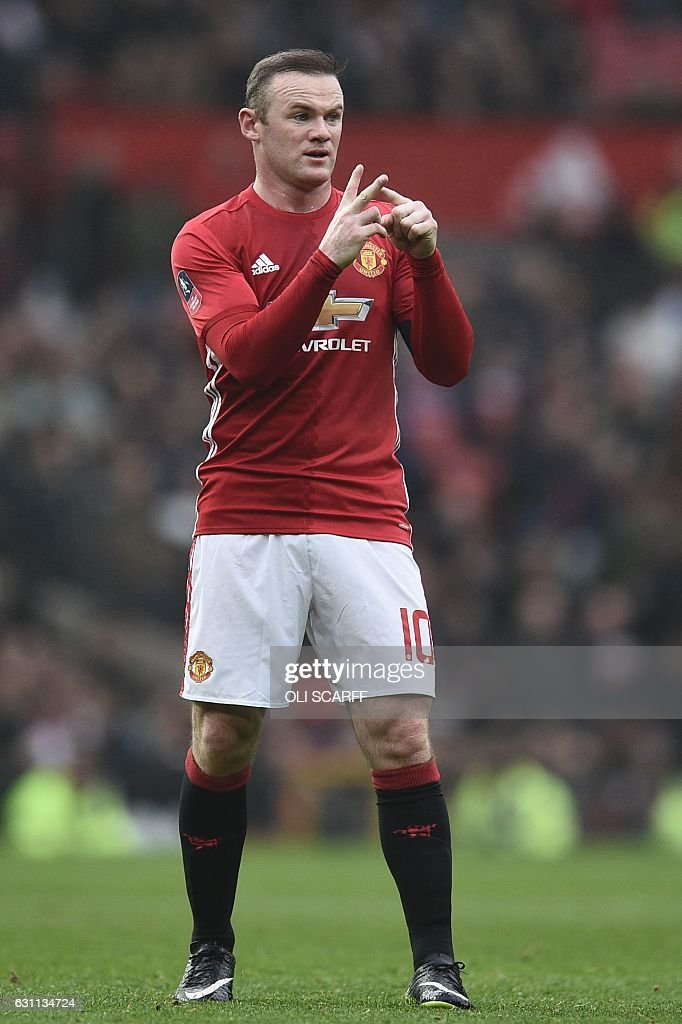 Manchester United's English striker Wayne Rooney gestures during the English FA Cup third round football match between Manchester United and Reading at Old Trafford in Manchester, north west England, on January 7, 2017. / AFP / Oli SCARFF / RESTRICTED TO EDITORIAL USE. No use with unauthorized audio, video, data, fixture lists, club/league logos or 'live' services. Online in-match use limited to 75 images, no video emulation. No use in betting, games or single club/league/player publications. /