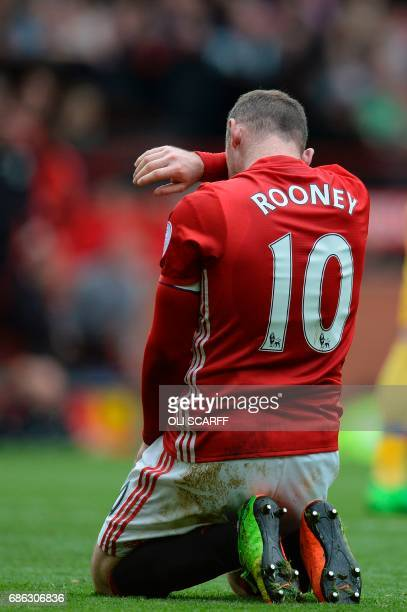 Manchester United's English striker Wayne Rooney gets up from the pitch during the English Premier League football match between Manchester United...
