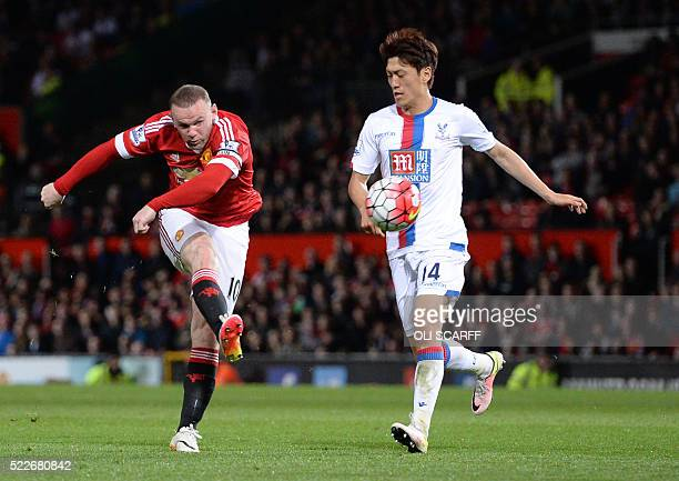 Manchester United's English striker Wayne Rooney has a shot on goal by Crystal Palace's South Korean midfielder Lee Chungyong during the English...