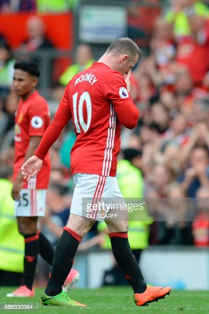 Manchester United's English striker Wayne Rooney leaves the pitch substituted during the English Premier League football match between Manchester...
