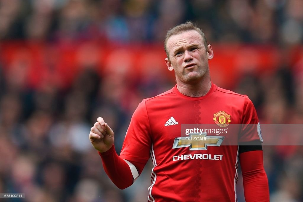 TOPSHOT - Manchester United's English striker Wayne Rooney reacts to the referee during the English Premier League football match between Manchester United and Swansea City at Old Trafford in Manchester, north west England, on April 30, 2017. / AFP PHOTO / Oli SCARFF / RESTRICTED TO EDITORIAL USE. No use with unauthorized audio, video, data, fixture lists, club/league logos or 'live' services. Online in-match use limited to 75 images, no video emulation. No use in betting, games or single club/league/player publications. /