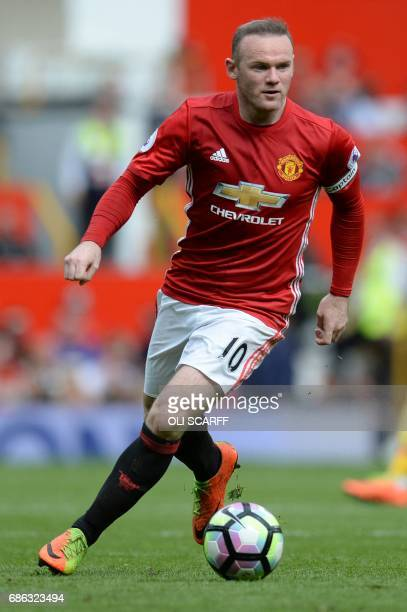 Manchester United's English striker Wayne Rooney runs with the ball during the English Premier League football match between Manchester United and...