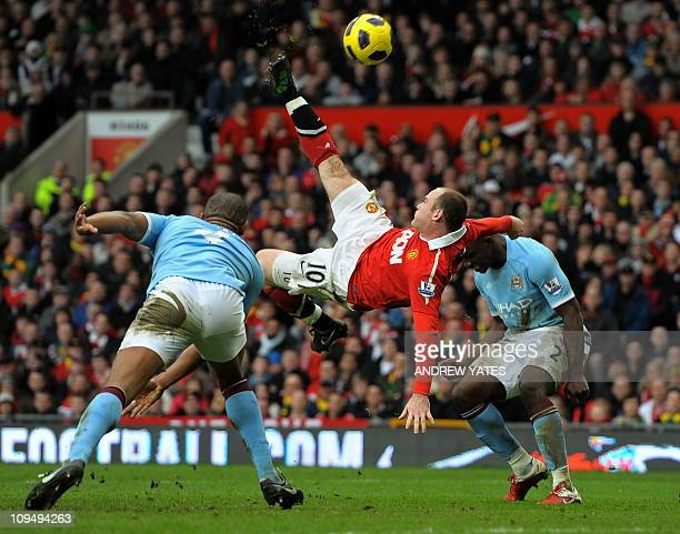 Manchester United's English striker Wayne Rooney scores their second goal during the English Premier League football match between Manchester United...