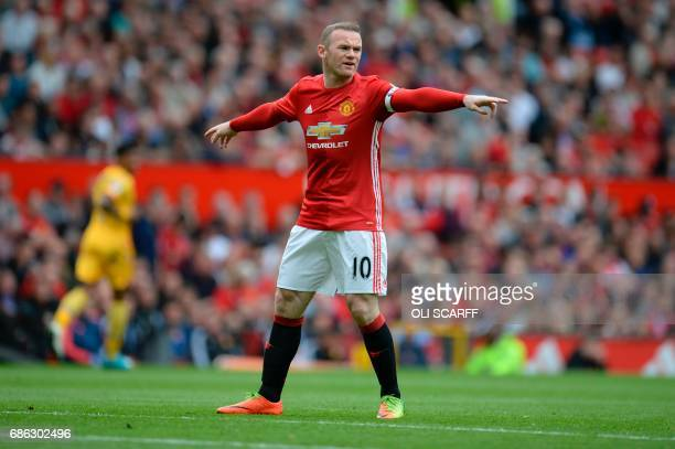 Manchester United's English striker Wayne Rooney shouts instructions during the English Premier League football match between Manchester United and...