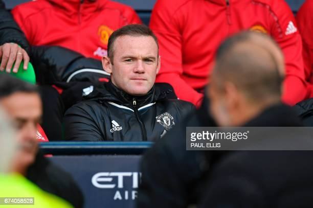 Manchester United's English striker Wayne Rooney sits on the substitutes bench ahead of the English Premier League football match between Manchester...