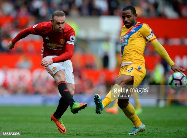 Manchester United's English striker Wayne Rooney takes a shot past Crystal Palace's English midfielder Jason Puncheon but does not score during the...