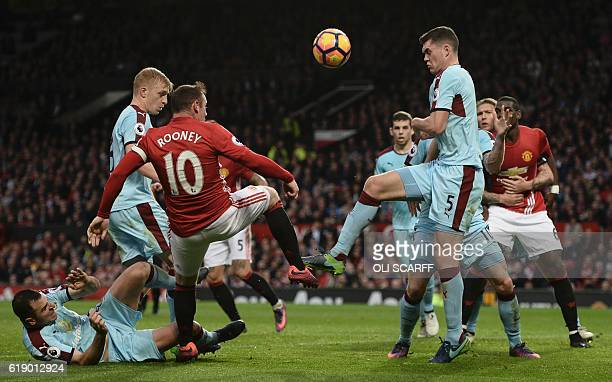 Manchester United's English striker Wayne Rooney vies with Burnley's English defender Michael Keane during the English Premier League football match...