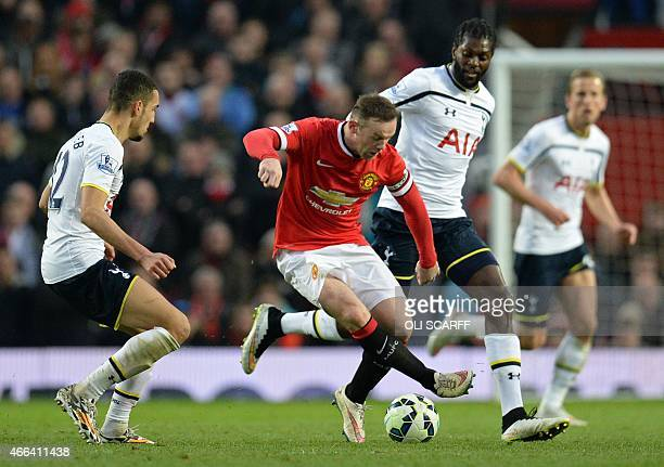 Manchester United's English striker Wayne Rooney vies with Tottenham Hotspur's French midfielder Nabil Bentaleb and Tottenham Hotspur's Togolese...