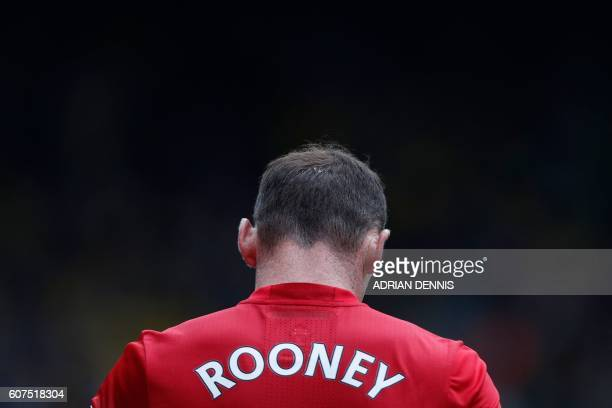 Manchester United's English striker Wayne Rooney walks from the pitch after losing the English Premier League football match between Watford and...