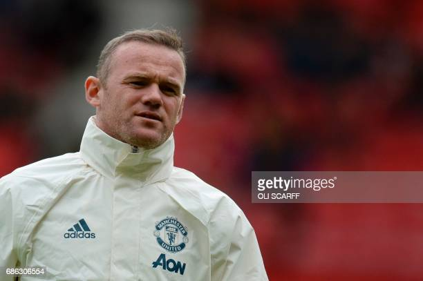 Manchester United's English striker Wayne Rooney warms up ahead of the English Premier League football match between Manchester United and Cyrstal...