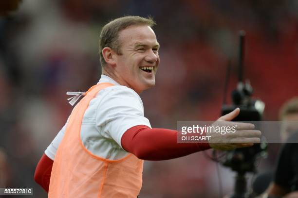 Manchester United's English striker Wayne Rooney warms up before the friendly Wayne Rooney testimonial football match between Manchester United and...