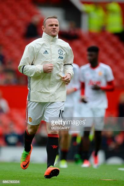 Manchester United's English striker Wayne Rooney warms up for the English Premier League football match between Manchester United and Cyrstal Palace...