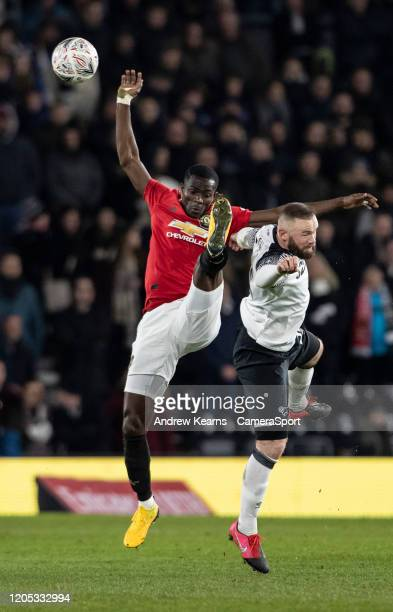 Manchester United's Eric Bailly competing with Derby County's Wayne Rooney during the FA Cup Fifth Round match between Derby County and Manchester...