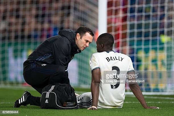 Manchester United's Eric Bailly gets treatment before having to leave the field during the Premier League match between Crystal Palace and Manchester...
