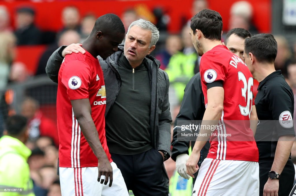 Manchester United's Eric Bailly with Manchester United manager Jose Mourinho (centre) after getting injured and leaving the game to be replaced by Manchester United's Matteo Darmian (right) during the Premier League match at Old Trafford, Manchester.