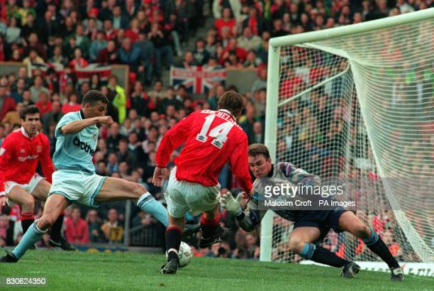 Manchester United's Eric Cantona is about to receive a cross from Andrei Kanchelskis and score during the derby match against Manchester City at Old...
